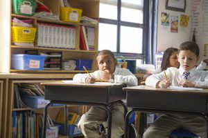 Young Students Listening to Teacher in Class