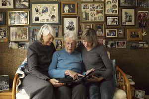Three Generations of Women Looking at Photo Album