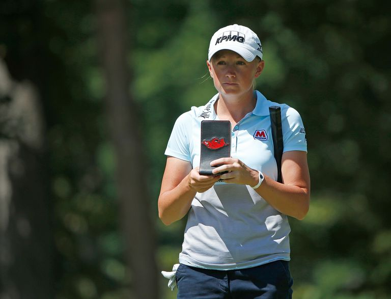 Stacy Lewis looks at her yardage book on the sixth green during the first round of the Marathon Classic presented by Owens Corning and O-I at Highland Meadows Golf Club on July 17, 2014