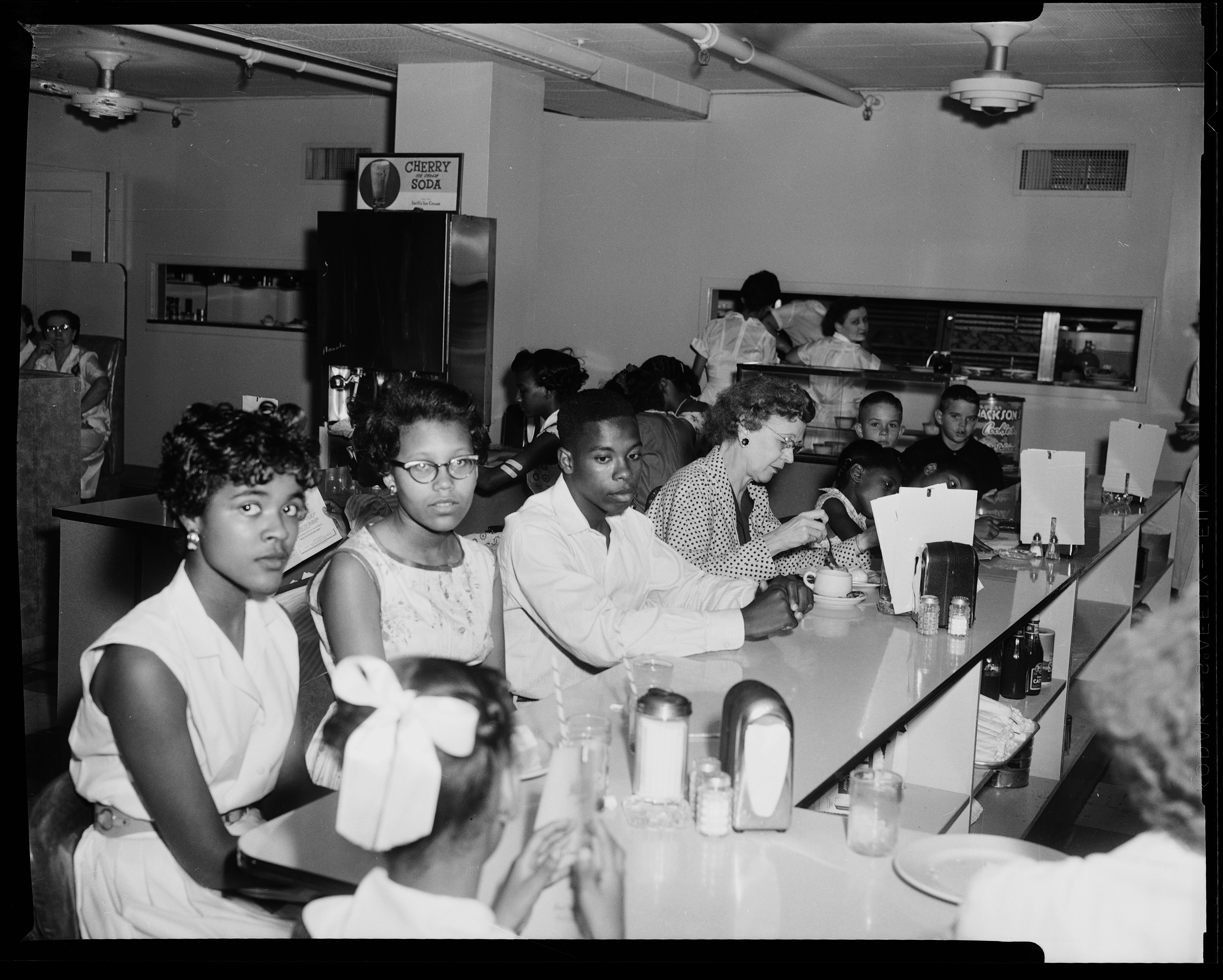People sitting an restaurant counter during civil rights sit in.