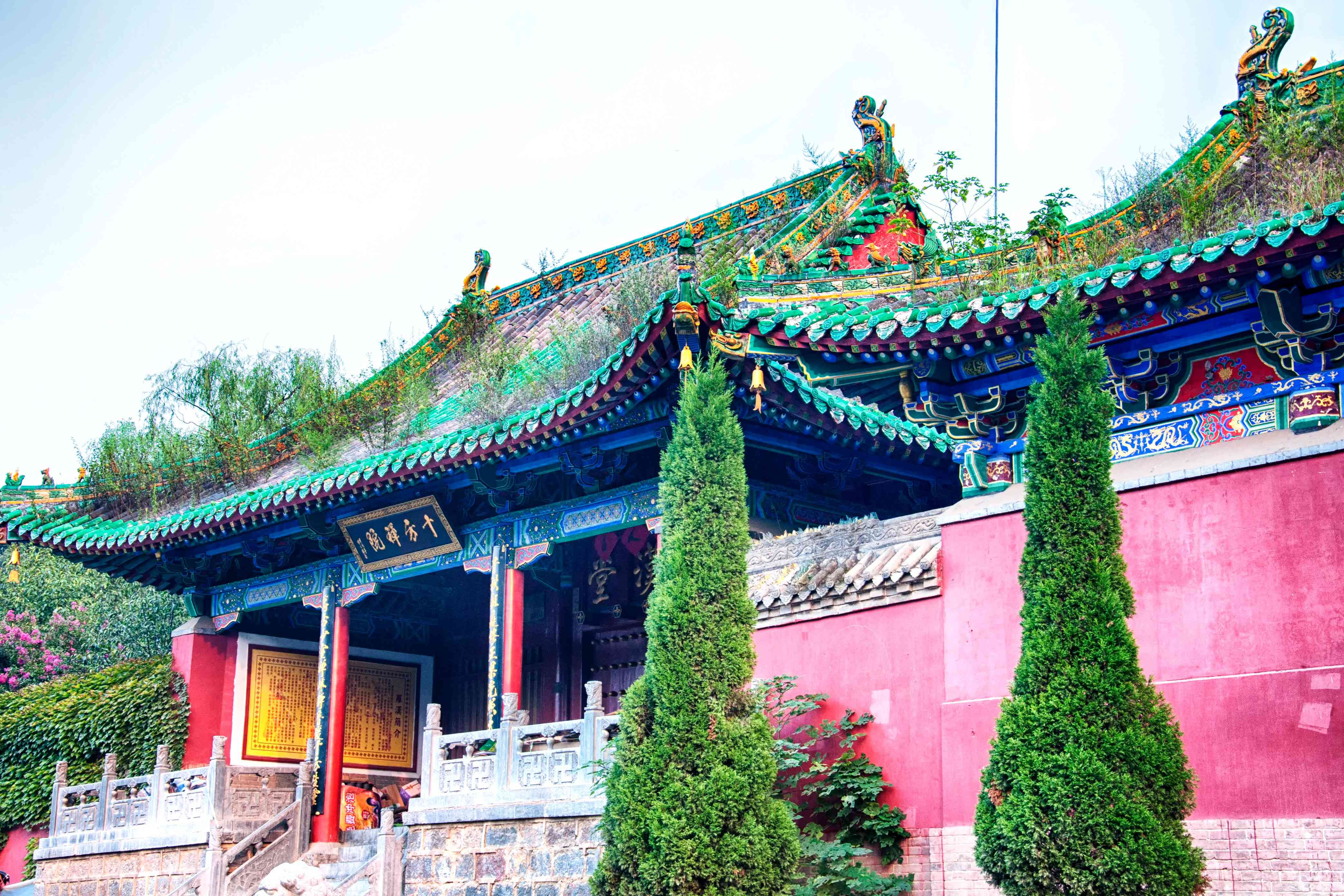 The colorful exterior and pagoda of Shifang Buddhist Temple on a sunny day in Dengfeng City, Henan