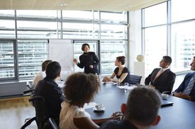 Business woman leading meeting