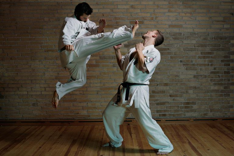 2 men practicing karate kicks / Self defence