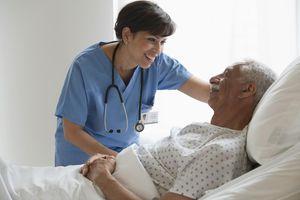Nurse with elderly male patient