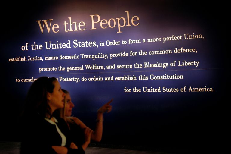 Two women looking at a display of the US Constitution