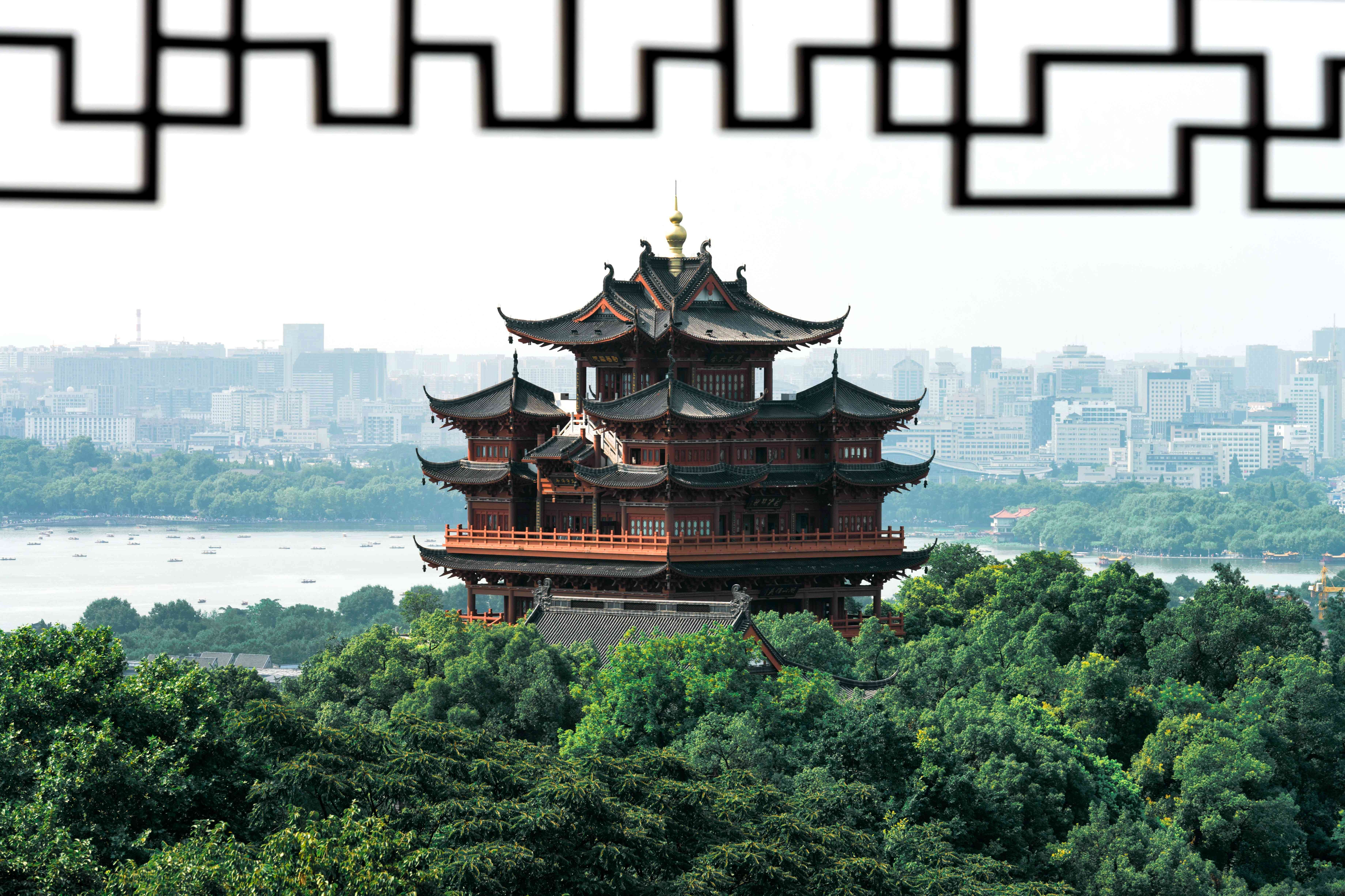A traditional pagoda set against the background of Hangzhou, the capital of Zhejiang