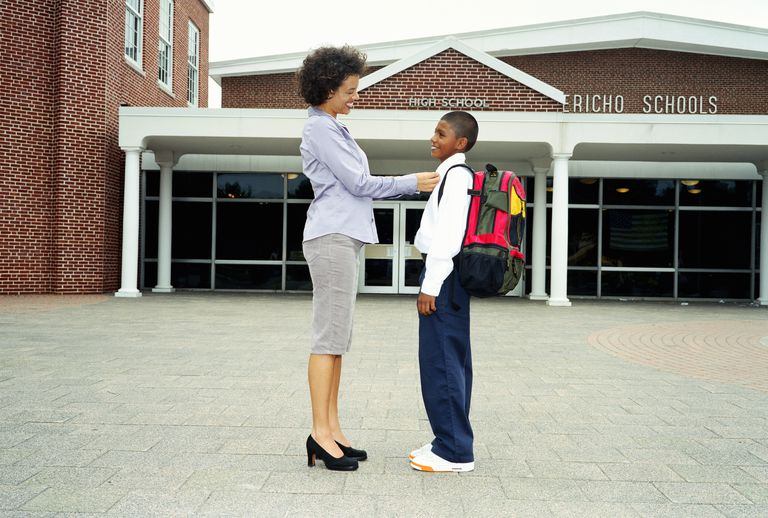 Woman and young boy outside school