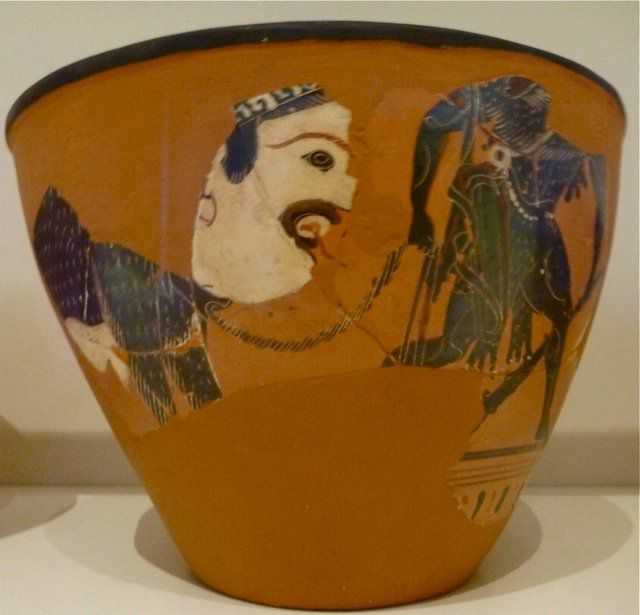 Hercules leading a big headed four-legged monster, late black figure bowl