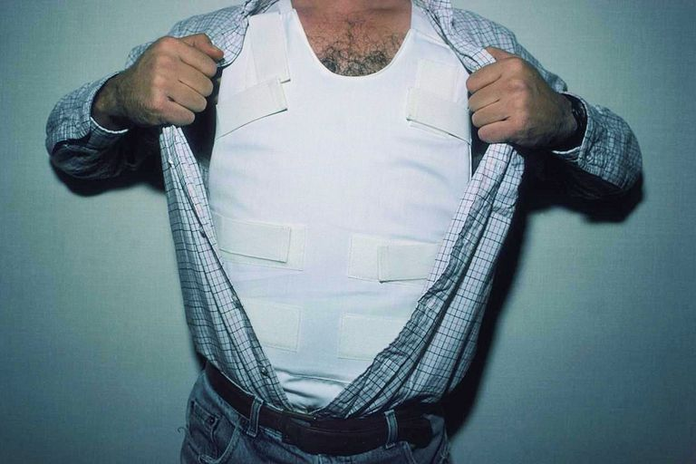 Man Showing Bulletproof Vest