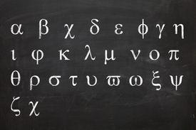 greek letters on black chalkboard