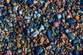 Colorful small rocks on Tofte beach, Norway.