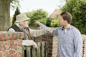 Senior man and younger man arguing