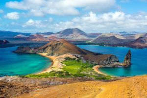 Scenic View of Mountain Amidst Sea at Galapagos Islands Against Cloudy Sky