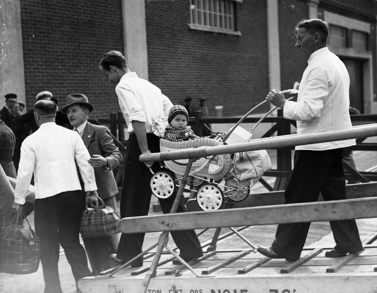 21st June 1939: Porters carry a baby from the SS Rhakotis at Southampton, where German Jewish refugees have arrived after being given the go ahead to stay in England