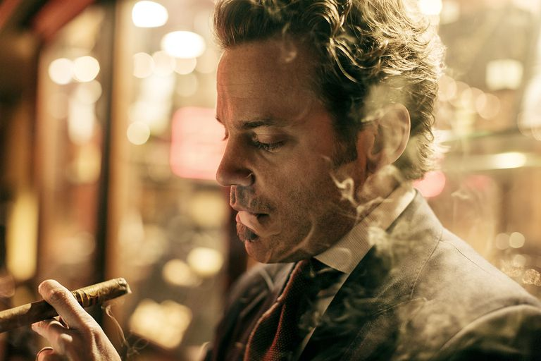 Michael Herklots smokes a cigar at the Nat Sherman Townhouse in Midtown Manhattan