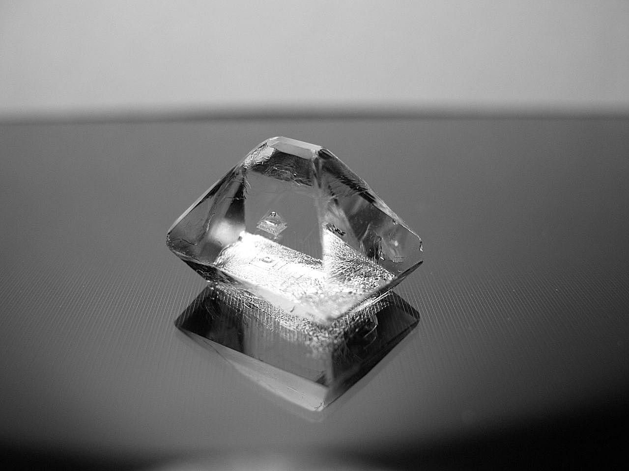 You usually can get a nice alum crystal overnight (shown here). If you let the crystal grow for a day or more, you can get larger crystals.