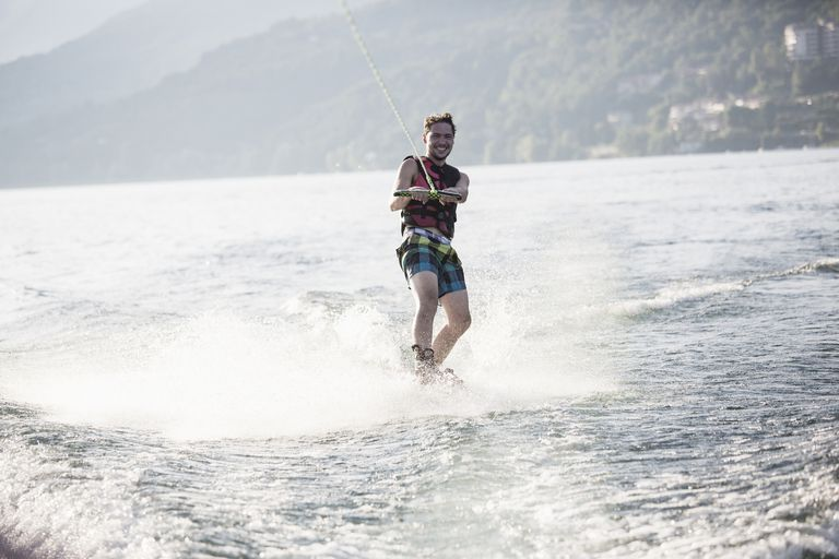Waterskier waterskiing, Maggiore lake, Verbania, Piedmont, Italy