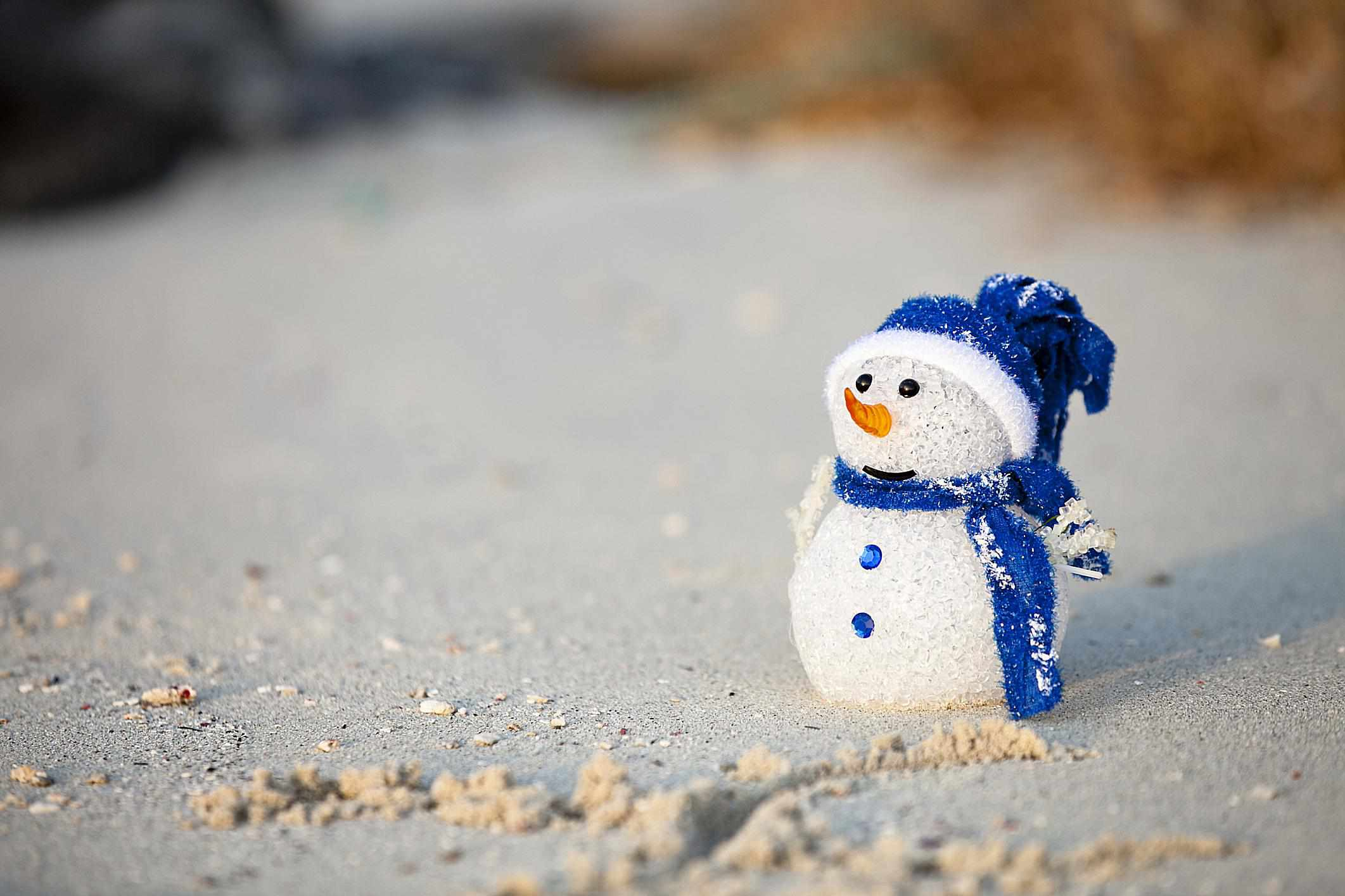 """A """"snowman"""" made from sand"""