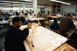 Architecture Student Working at a Drafting Table