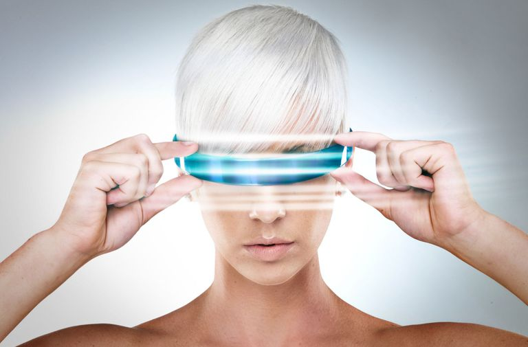 Futuristic looking woman wearing cool blue glasses of some kind