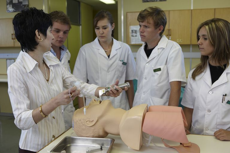 Doctor demonstrating respiratory care techniques to medical students