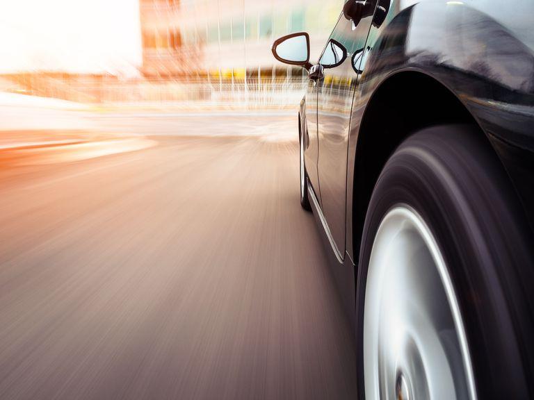 Car speeding towards an office, Illinois, America, USA