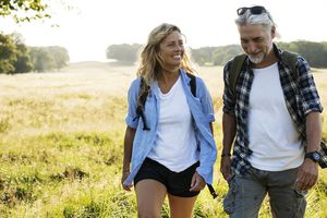 Smiling Mature Man and Woman hiking