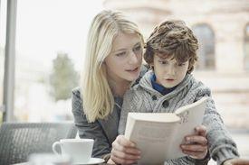 Woman reading to little boy