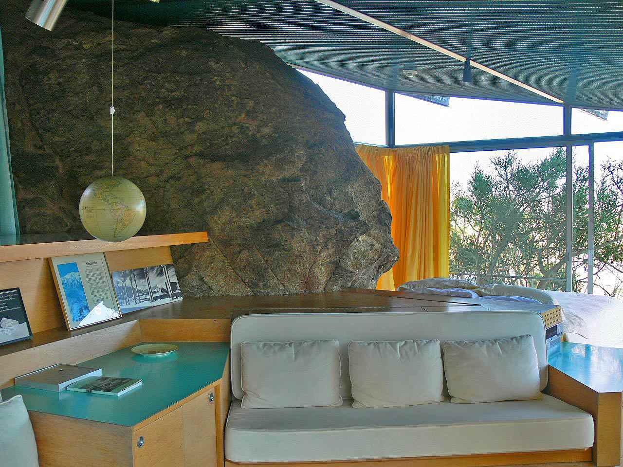 An enormous boulder is incorporated into the design of the Frey House II by architect Albert Frey