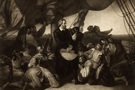 Christopher Columbus on a ship with crew