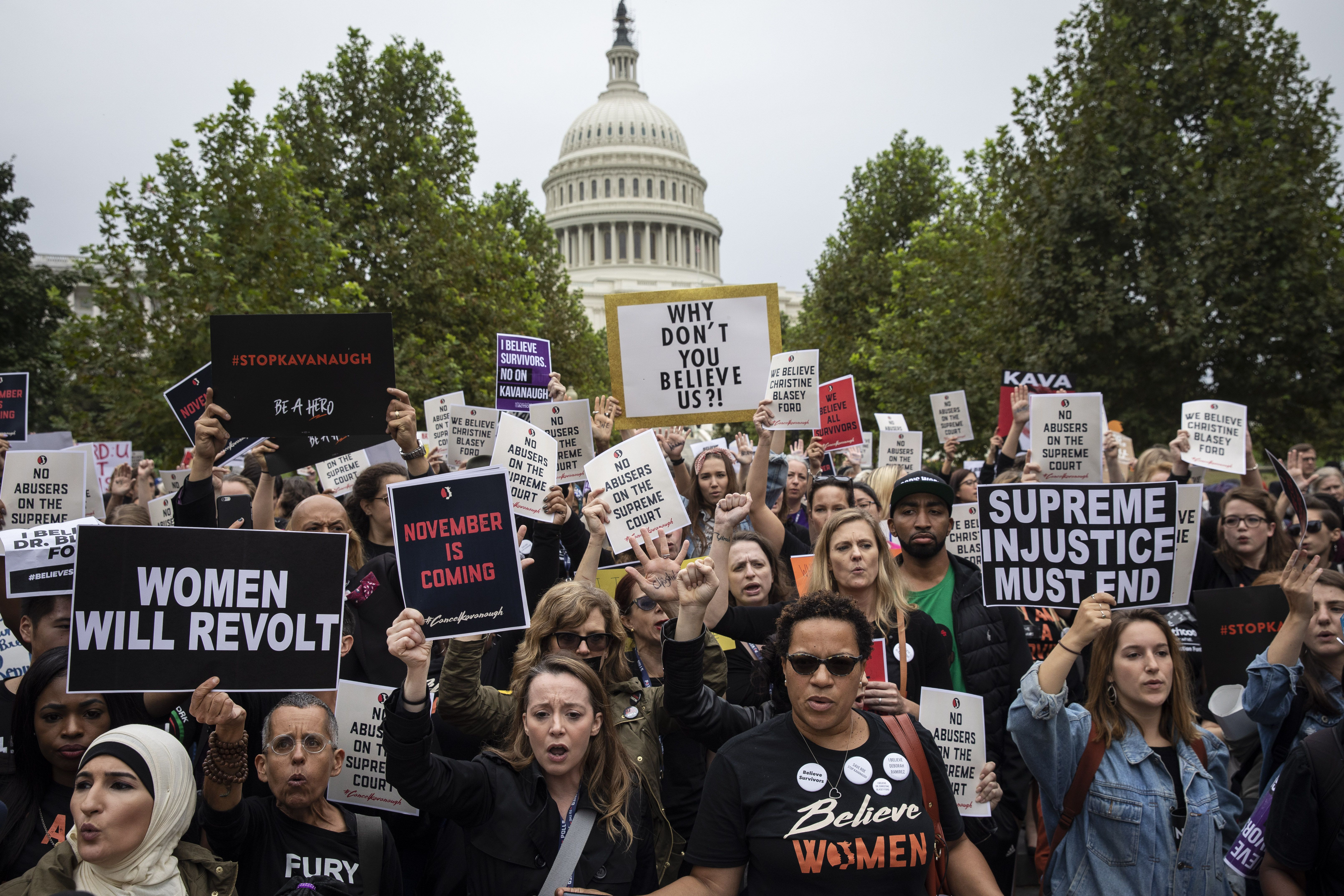 Protestors rally against Supreme Court nominee Judge Brett Kavanaugh as they march on Capitol Hill in Washington, DC.