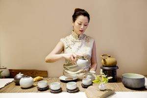 Woman performing a Chinese tea ceremony