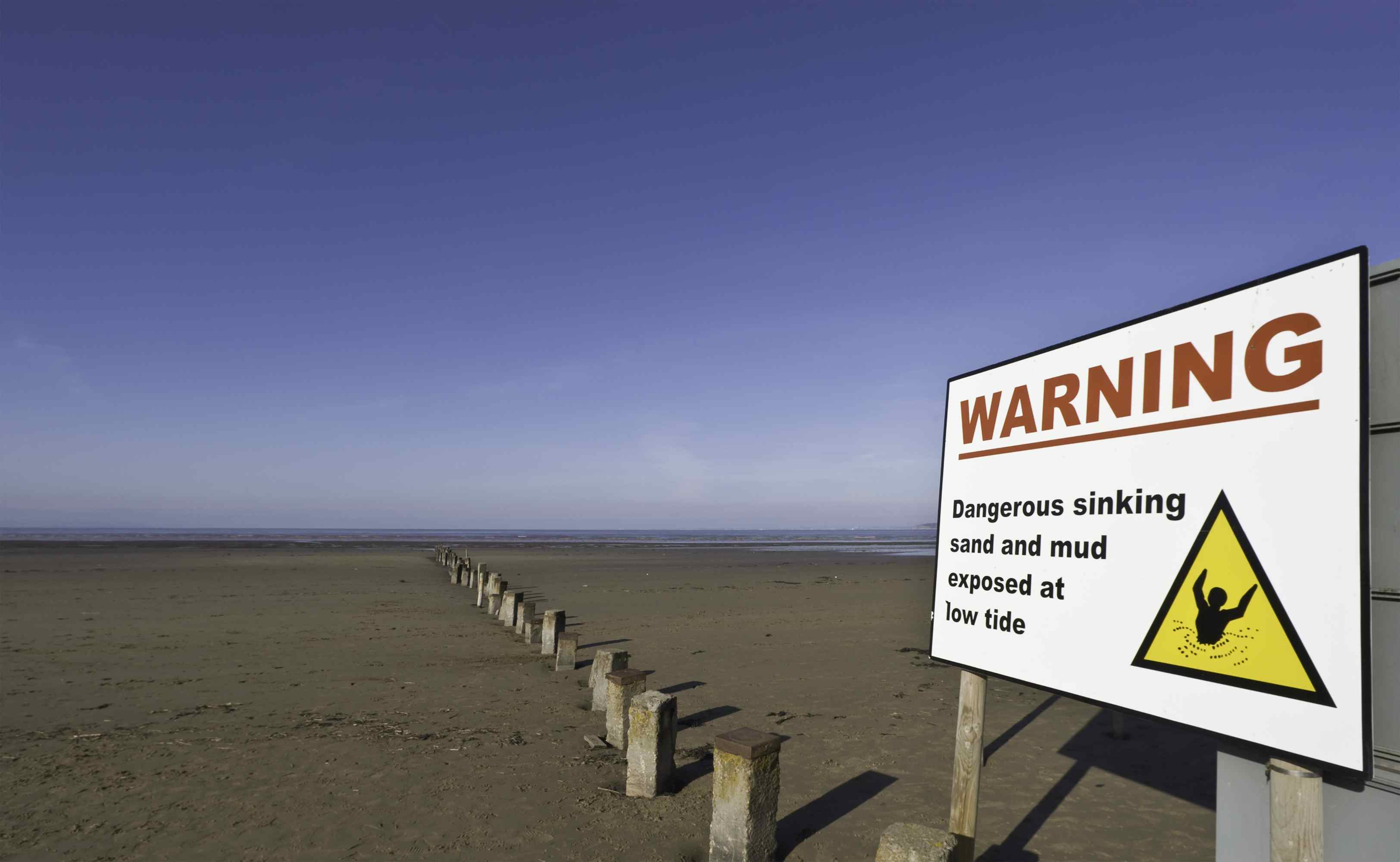 Quicksand may occur anywhere, but places prone to it often post warning signs.
