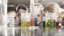 Kids at eye level with laboratory glassware