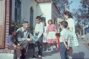 Theodor Seuss Geisel Reads To Children Outside.