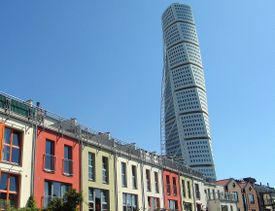 Turning Torso, Västrahamnen, Malmö, Sweden, behind row of brightly colored houses