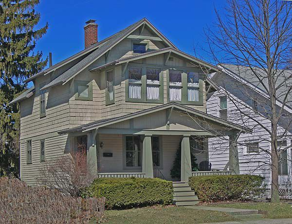 Many Craftsman houses have thick, pyramid-shaped porch columns.