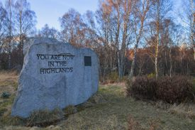 A sign welcoming visitors to the Scottish Highlands