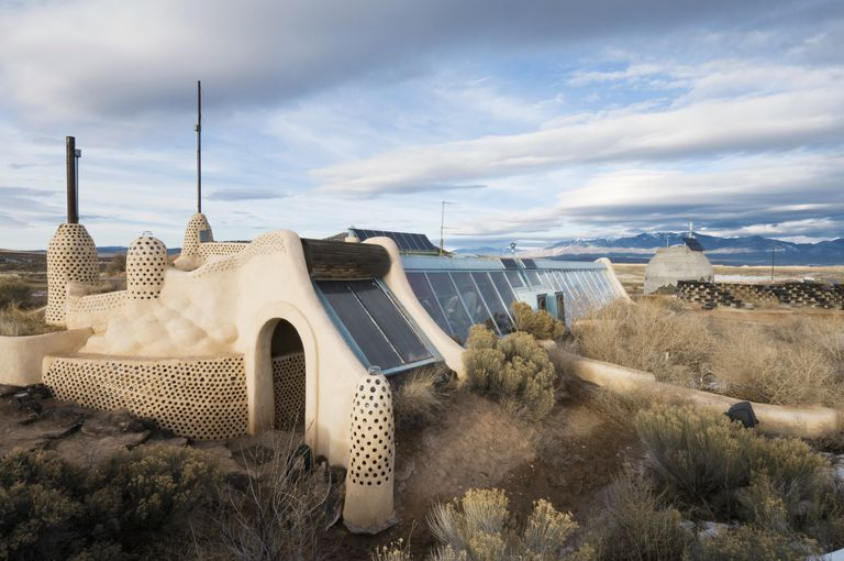 Adobe Style Self-Sustainable Solar and Wind House Made From Recycled Materials
