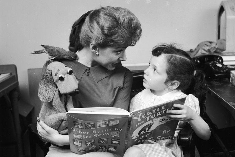 Shari Lewis reads the tale of Yertle the Turtle to a young girl