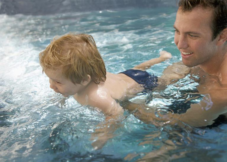 A man and a baby boy in a swimming pool