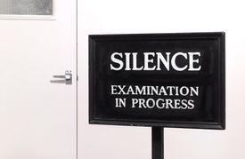 Landscape examination in progress sign