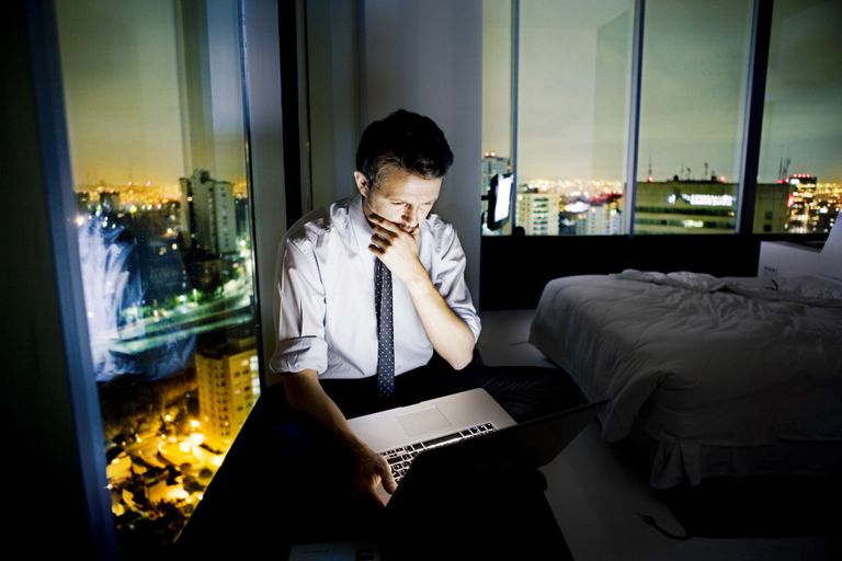 Man on laptop in hotel