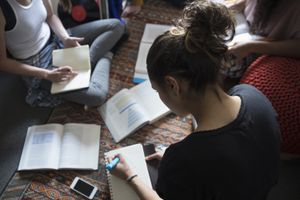 Students studying textbooks