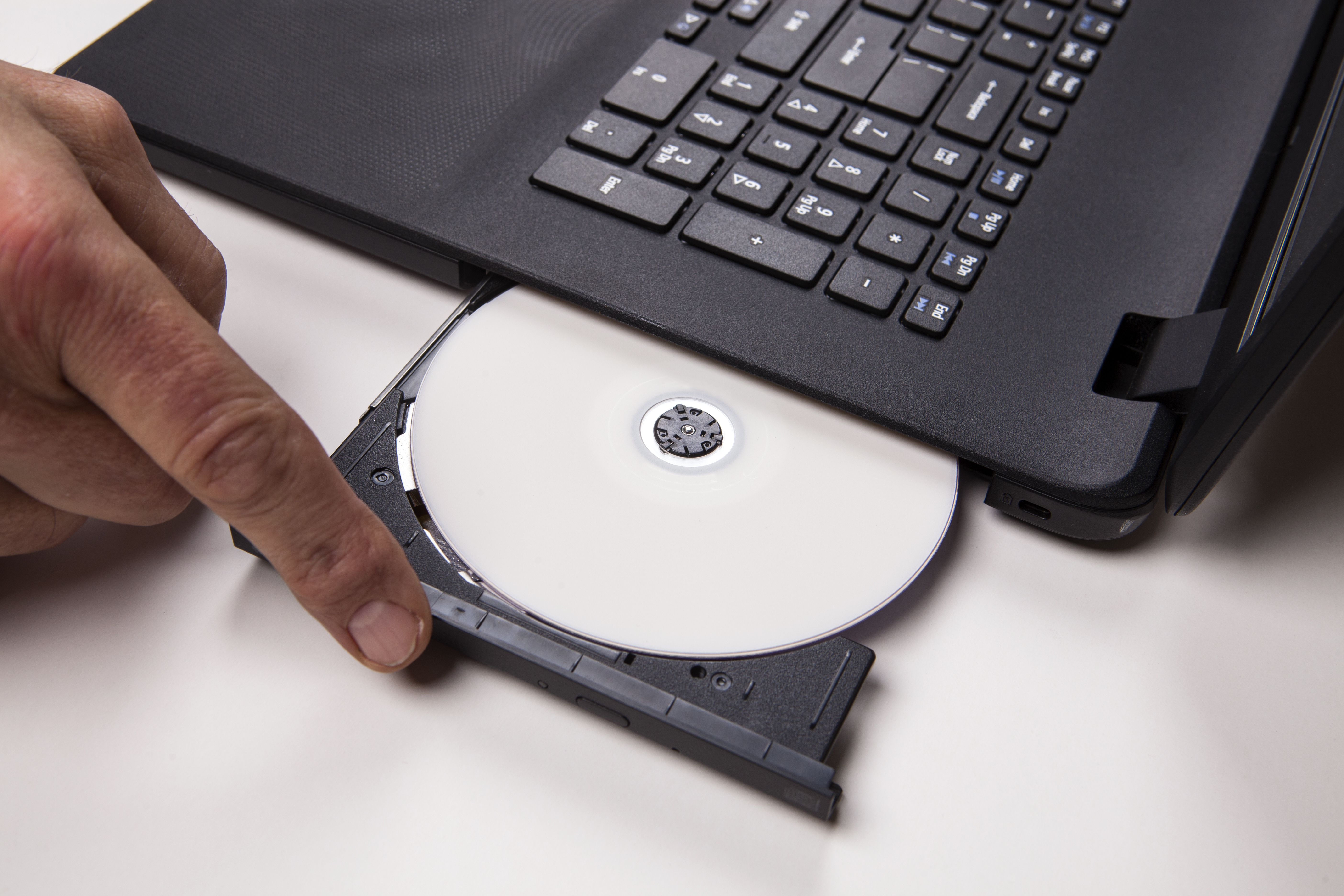 Loading CD into laptop