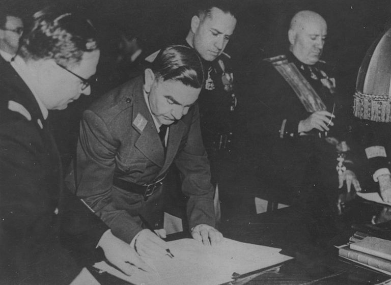 Ante Pavelic signing a document
