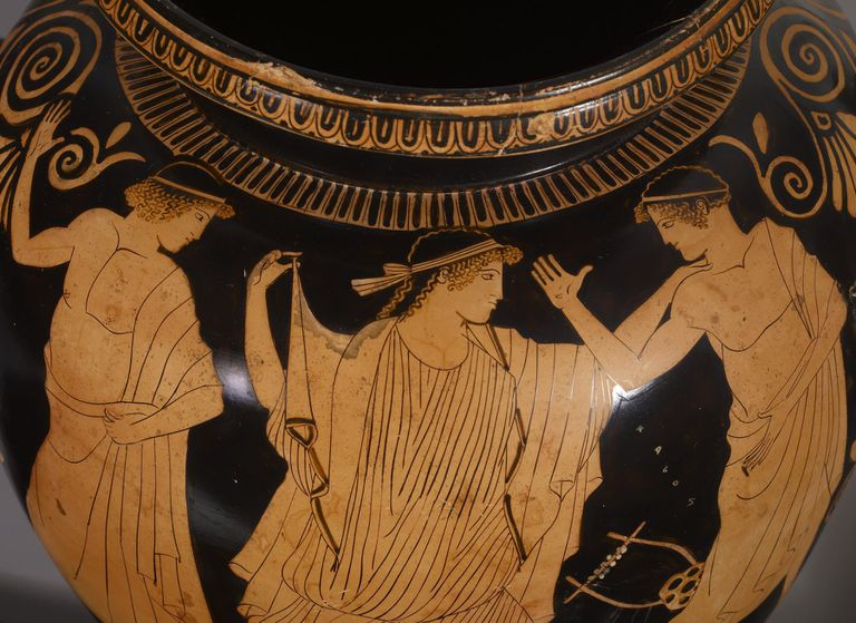 Grecian urn showing a woman standing between two amorous men.