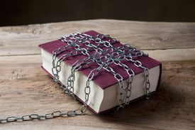 Book with chains wrapped around it