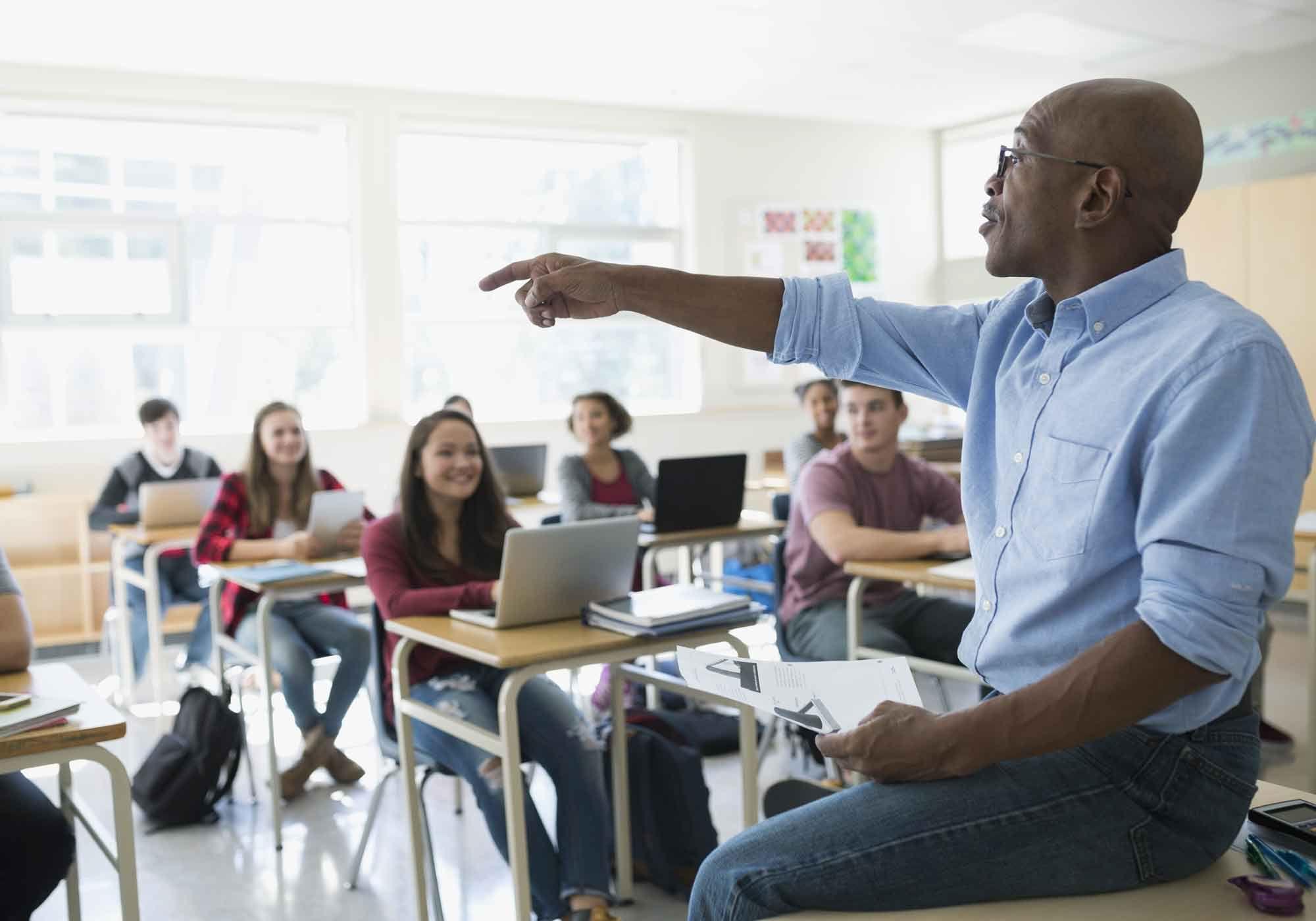 A teacher calls on a student
