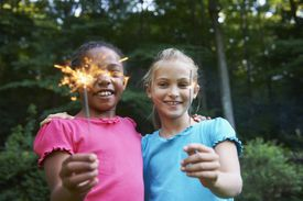 2 girls playing with sparklers
